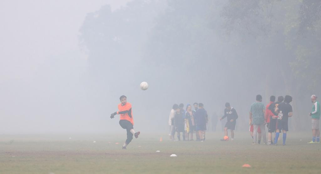 With the capital choking in polluted, toxic air, its residents having flouted COVID-19 norms and there being a scientifically-proven link between COVID-19 and air pollution, what lies ahead? Well, only the coming months will tell. Here, youngsters play soccer in the smog near India Gate. Photo: Vikas Choudhary / CSE
