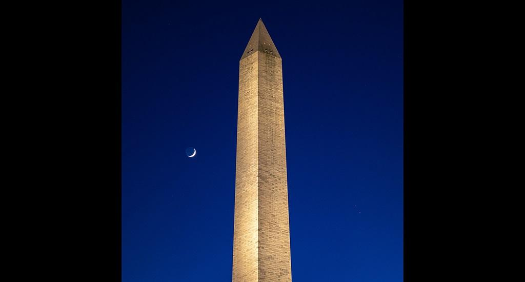 December 21 is the winter solstice, the longest night of the year in the Northern Hemisphere. This year though, the world will also witness a spectacular celestial event on this night. In this photo, the Moon, left, Saturn, upper right and Jupiter, lower right, are seen after sunset with the Washington Monument December 17, 2020, in Washington, DC. Both planets will be 'in conjunction' with each other December 21. Photo: National Aeronautics and Space Administration
