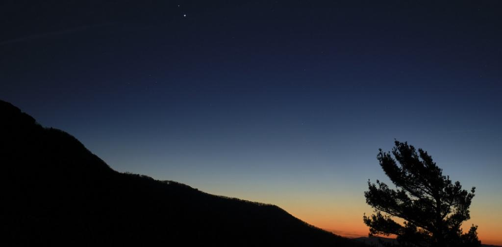 For watching the event, just wait for an hour after sunset. Then, look onto the southwestern sky with either a binoculars or a simple telescope. Here, Saturn, top and Jupiter, below, are seen after sunset from Shenandoah National Park in Viginia, US, December 13, 2020. Photo: NASA