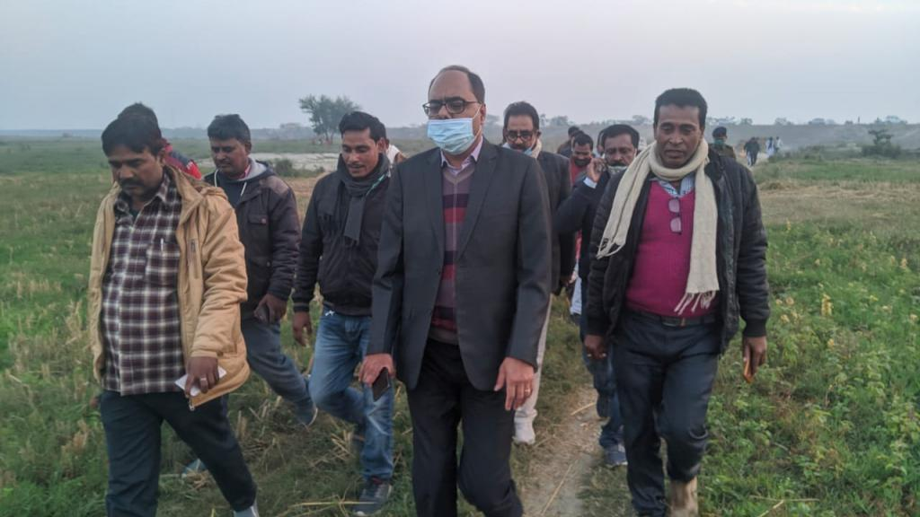 Muzaffarpur district magistrate Chandra Shekhar Singh (wearing mask) inspecting agricultural fields. He is accompanied by agriculture department officials.