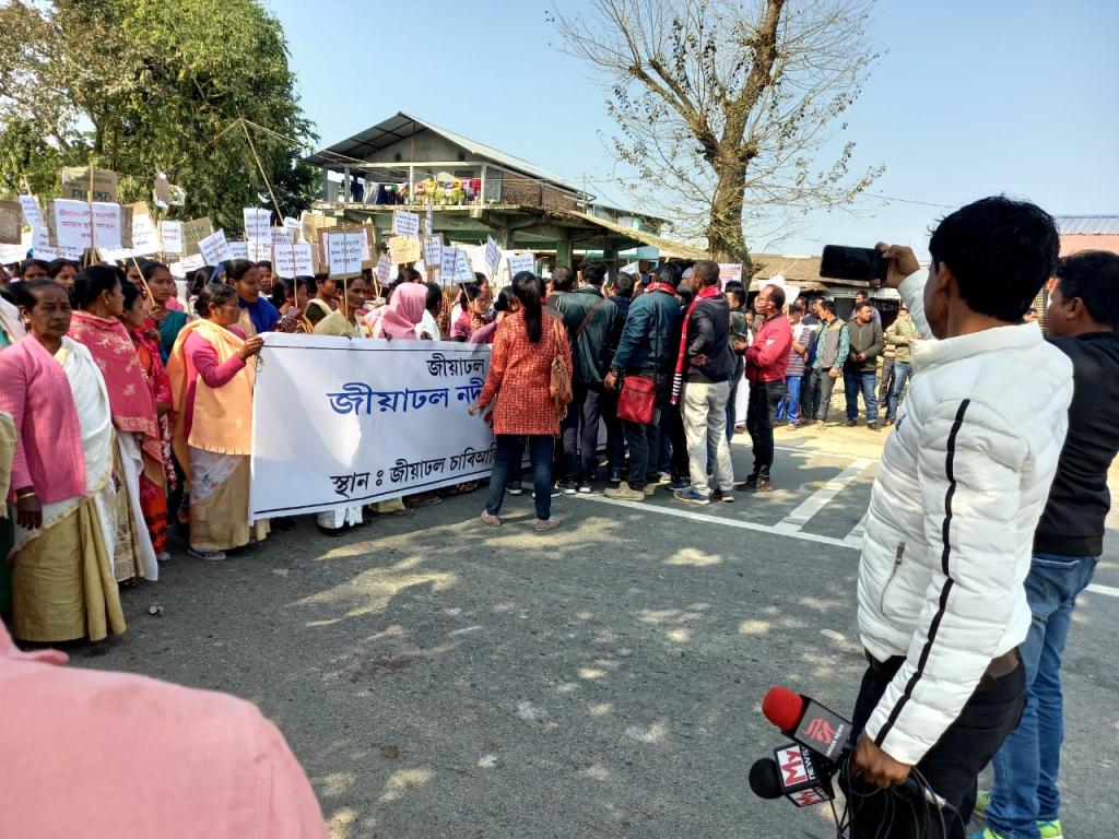 Thousands descended on the National Highway-15 to protest against the state government's alleged tardiness to control erratic flooding of the Jiadhal river. Photo: Harish Pegu