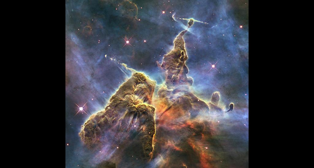 The image, called the Mystic Mountain, captures the chaotic activity atop a three-light-year-tall pillar of gas and dust being eaten away by the light from nearby bright stars. Photo: NASA