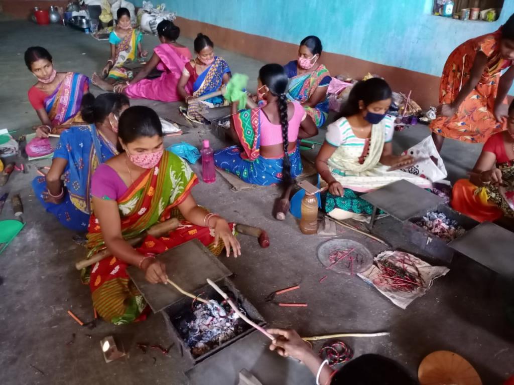 Tribal women make crafts item from lac. Photo: Ashis Senapati