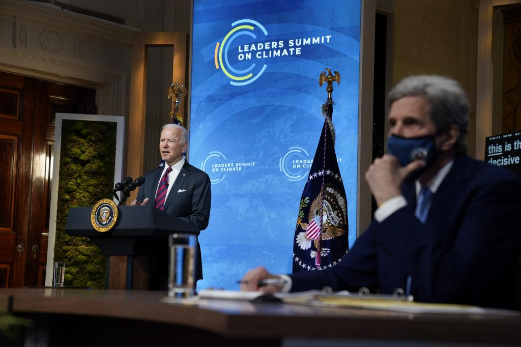 US President Joe Biden, with presidential climate envoy John Kerry, opened the Leaders Summit on Climate April 22, 2021, by announcing new US targets. Photo: The Conversation / AP Photo / Evan Vucci