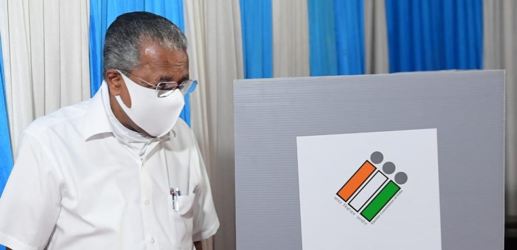 Pinarayi Vijayan casting his vote. Photo: @CMOKerala