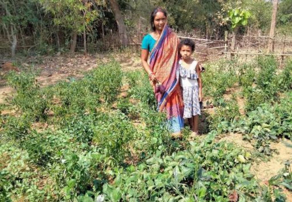 Niati Naik with her daughter at a kitchen garden. Photo: Srinibas Das
