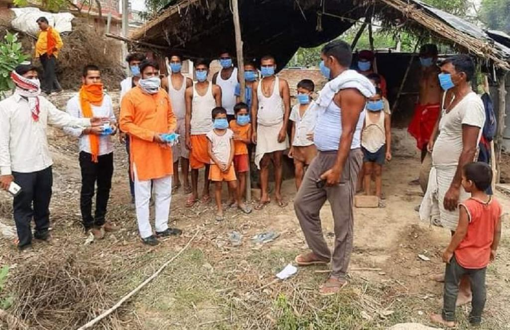 Bharatiya Janata Party Workers distributing masks and sanitisers in UP's Barabanki and Ghazipur districts. Photo: @BJP4UP / Twitter