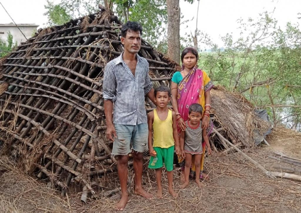 A cyclone-hit family standing in front of their damaged house in Kendrapara district. Photo: Ashis Senapati