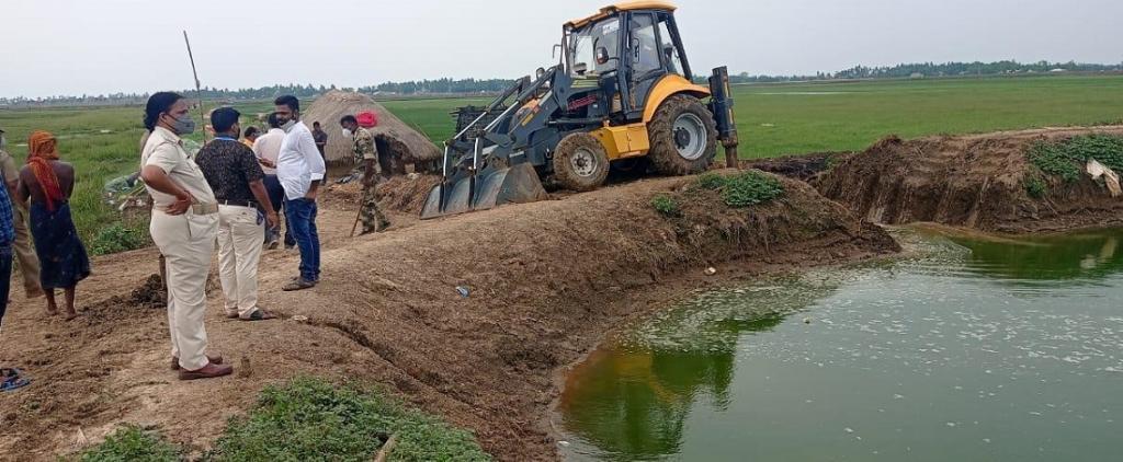 Officials demolishing illegal prawn farms in Dibakarpur village. Photo: Ashis Senapati