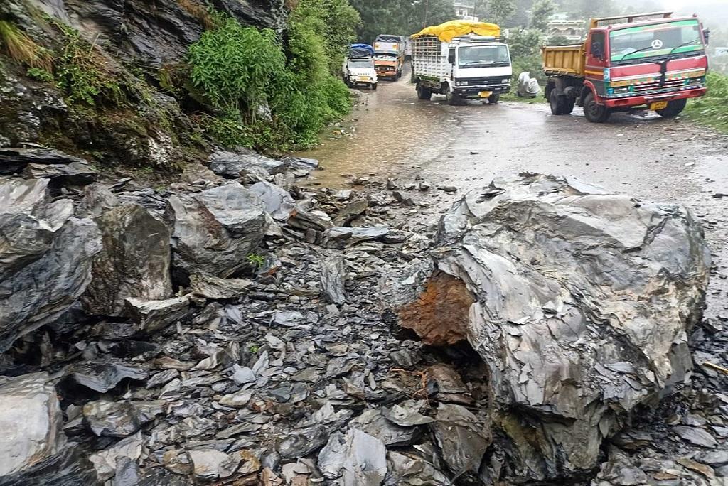 A road in Uttarakhand blocked by debris due to heavy rains. Photo: Trilochan Bhatt