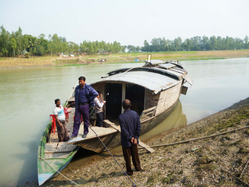 A library boat docks near Pasbetuan village in Pabna district of Bangladesh for a couple of hours before moving on to another place.