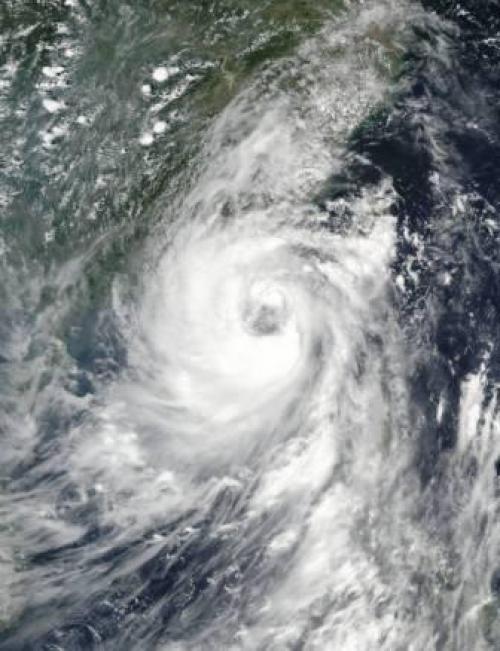 NASA-NOAA's Suomi NPP satellite captured this visible light image of Typhoon Nida approaching China Credits: NASA/NOAA