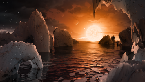 This illustration shows the possible surface of TRAPPIST-1f, one of the newly discovered planets in the TRAPPIST-1 system. Scientists using the Spitzer Space Telescope and ground-based telescopes have discovered that there are seven Earth-size planets in the system