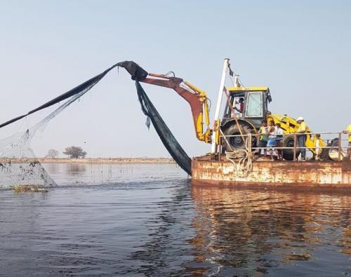 Odisha starts evicting illegal prawn gherries in Chilika