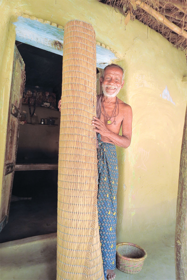 A villager holds a mattress made from