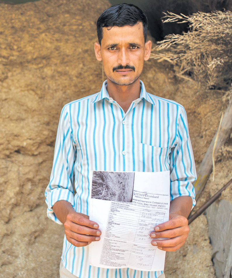 Sachin of Uttar Pradesh's Garhi Pukhta village shows a copy of his claim intimation form. His family lost 90 per cent of their paddy crop in kharif 2016