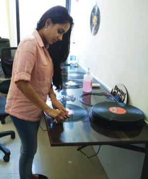 Amishi Shah, founder of Mumbaibased The UpCycle Co, breaks down a vinyl record to make an aesthetic product from it (COURTESY: THE UPCYCLE CO)
