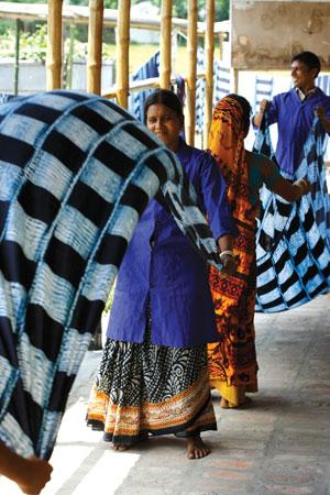Workers of Bangladesh-based non-profit Nijera Cottage and Village Industries dry