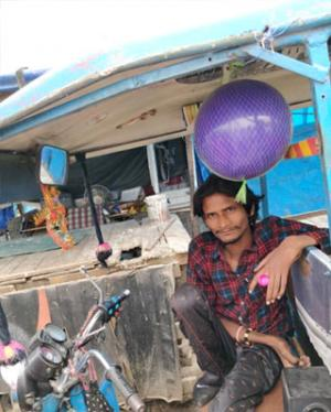 Chunnu Babua, the physically challenged driver at Harkesh Nagar, New Delhi