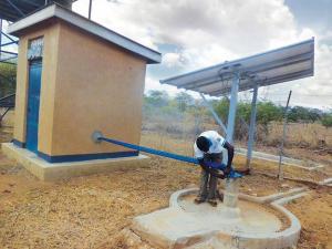 Farmers in Laboktom village of Uganda's Amudat district irrigate the farm using solar-powered pumps (Credit: Lominda Afedraru)