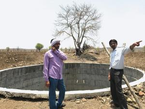 Mahesh Madhukar Besadkar (right) of Maharashtra's Yavatmal district says that his open well has been dry for months and he has not been able to cultivate rabi crop this year (Photographs: Nidhi Jamwal)
