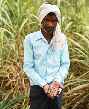 Roshan Lal of Kunwarpur Basit village in Hardoi district says he needs to mortgage his wife's gold earrings to pay bank loan because Ajbapur mill has not given him R2 lakh for the sugarcane he 