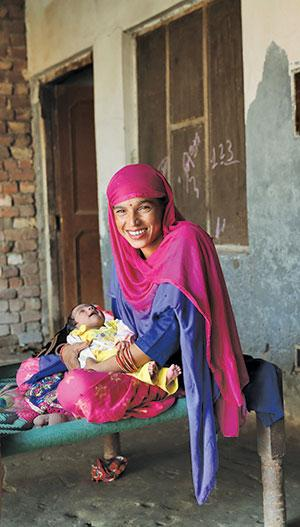 Mausami, a resident of Karnal, Haryana, holding her newborn child, Karishma, who is the first beneficiary of the Pradhan Mantri Jan Arogya Yojana (Photo: Srikant Chaudhary)