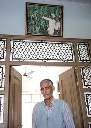 A resident of Jaunti, the village where Green Revolution started, has left farming. The photograph of his grandfather along with a scientist of the Indian Agricultural Research Institute hangs above