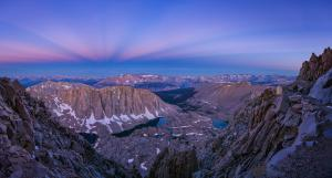 During the twilight hour on August 8, 2019, the blue hour panorama scanned along the clear western sky and looked down at Mt Whitney, from along the John Muir Trail towards the Sierra Nevada mountain range. The Belt of Venus seems to be bordering the fall