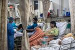 Selling a buffalo for a brain scan: India's COVID-19 crisis reveals deep fractures in its health system