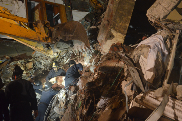 Alima Sheikh (50) was found dead by rescue workers at around 12: 45 am as the rescue workers sought to clear the debris and find people sandwiched inside.      Photograph by: Akshay DeshmaneRead Story : Ten dead, six injured in Mumbai building collapse