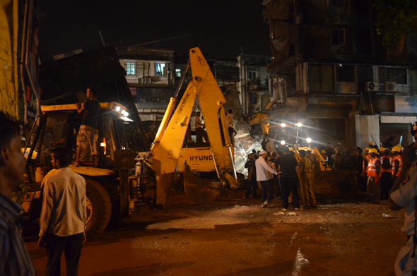 Northern part of a six storey building on Cadell road in Mahim collapsed after 8 pm on Monday night. It sandwiched at least 11 people in the resultant debris and another 10-15 people were stuck in the remaining portion of the building, which did not collapse. They were eventually rescued by the Mumbai Fire Brigade. Photograph by: Akshay DeshmaneRead Story : Ten dead, six injured in Mumbai building collapse