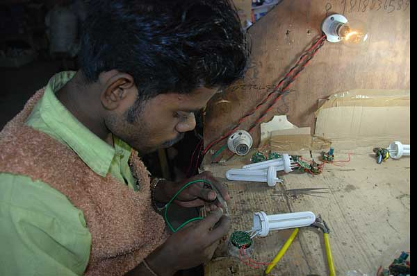 """Motinagar, New DelhiTheir means may be modest but they claim to offer a wide variety in products.  There are about 50,000 odd CFL assemblers in the small-scale sector in India.  """"It is almost like a cottage industry"""", says DC Agarwal the ex-president of the  board of small-scale manufacturers of CFL. The CFL market ranges from the cheap,  low quality lamps to the more expensive but durable, high quality lamps(By Arnab Pratim Dutta (Reporter, Down to Earth)Photographs by Meeta  Ahlawat)"""