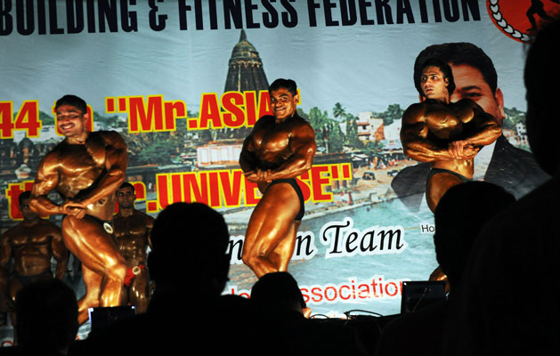 32 year old Kamaraj (centre) at the national selection trials for the 44th Mr. Universe at Wai, Maharashtra. Three times Mr India, his diet comprises of sixty egg whites, two kilos of boiled chicken breasts and an array of nutritional supplements. Although he earns Rs.19,000 from his army job, he spends more than 25,000 every month on diet and supplements.Photographs by: Sayantan Bera