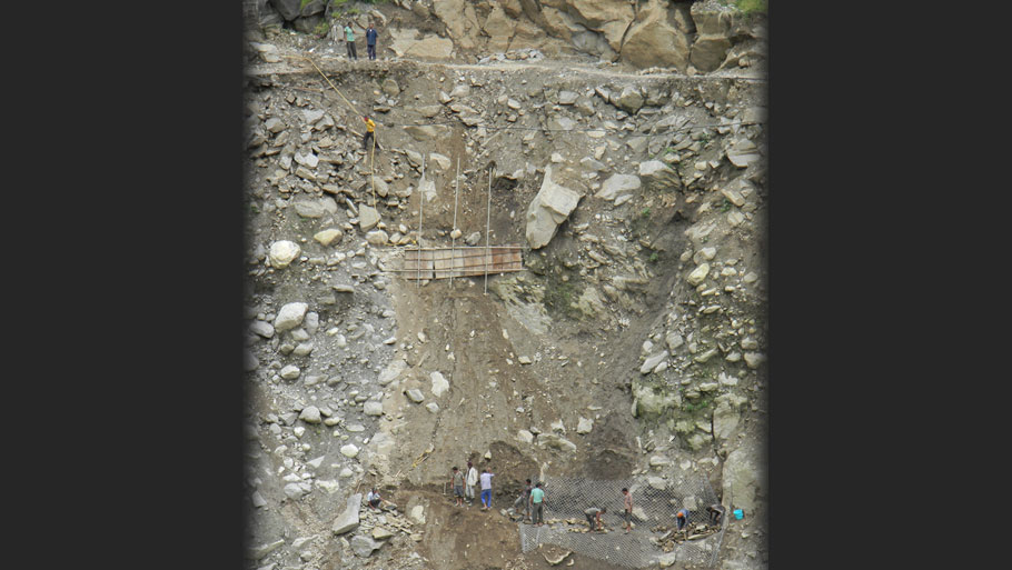 Road repairs going on near the office of NHPC's 280 MW Dhauliganga power plant in Dharchula. The main road leading to the HEP site caved in at several places Photographs by: Soma Basu Read more: Uttarakhand floods: is the disaster human-induced?