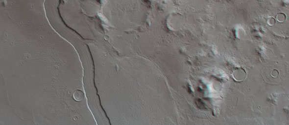 This perspective view shows one of the mountains in the Promethei Terra Highlands with nearby sediment-filled impact cratersThis region shows a striking resemblance to the morphology found in regions on Earth affected by glaciation. For example, we can see circular step-like structures on the inner walls of the sediment-filled crater in the foreground of the second perspective view. Planetary scientists think that these may represent former high water or glacial levels, before ice and water sublimated or evaporated away in stages at various times