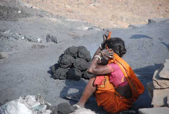 More coal means more money. Women folk carry upto 60 to 80 kg of coal on their head every day from the mining site to the market place, seven km awayReport by: Alok Kumar Gupta Photographs by: Sandip Kumar Nag