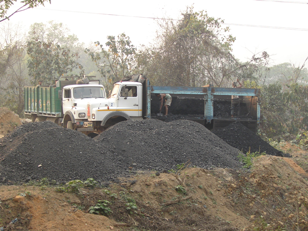 The coal is merely dumped at a number of pre-determined locations only to be picked up by different trucks mostly with a view to transport it out of Meghalaya. Photograph by: Sugandh Juneja