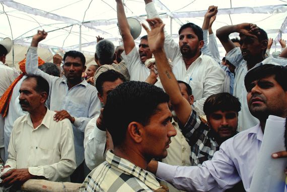 Public hearing commences amid strong protests by local people. Sahib Gotarar, district information officer, tries to pacify the crowd as officials speak Photographs by: Srestha BanerjeeRead also: Haryana village protests nuclear power plant