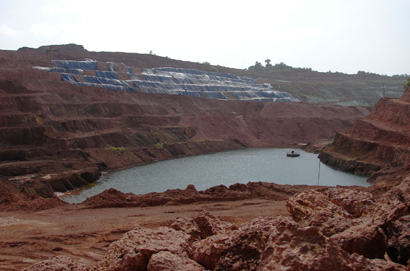 The Dempo mine in Bicholim which now belongs to Sesa Goa. The blue tarpaulin covered area depicts the ore containing area while the green covering is jute covering over a stabilising overburden dumpPhotographs by Sugandh Juneja