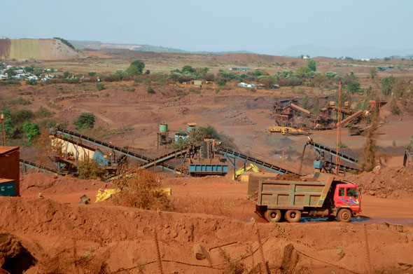 NMDC's mine in Kumarswamy forest ranges in Sandur taluk. Kamtur village can be seen in the background. The village is surrounded by seven mines. Behind the village , a hillock of overburden (waste from the mine)Photographs by M Suchitra