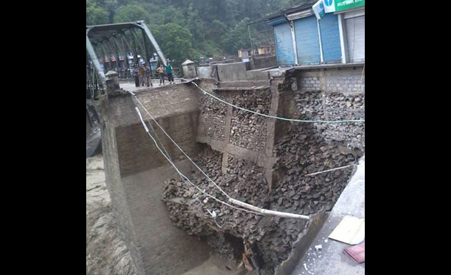 Heavy rains have washed away the road beyond the Pinderghati bridge