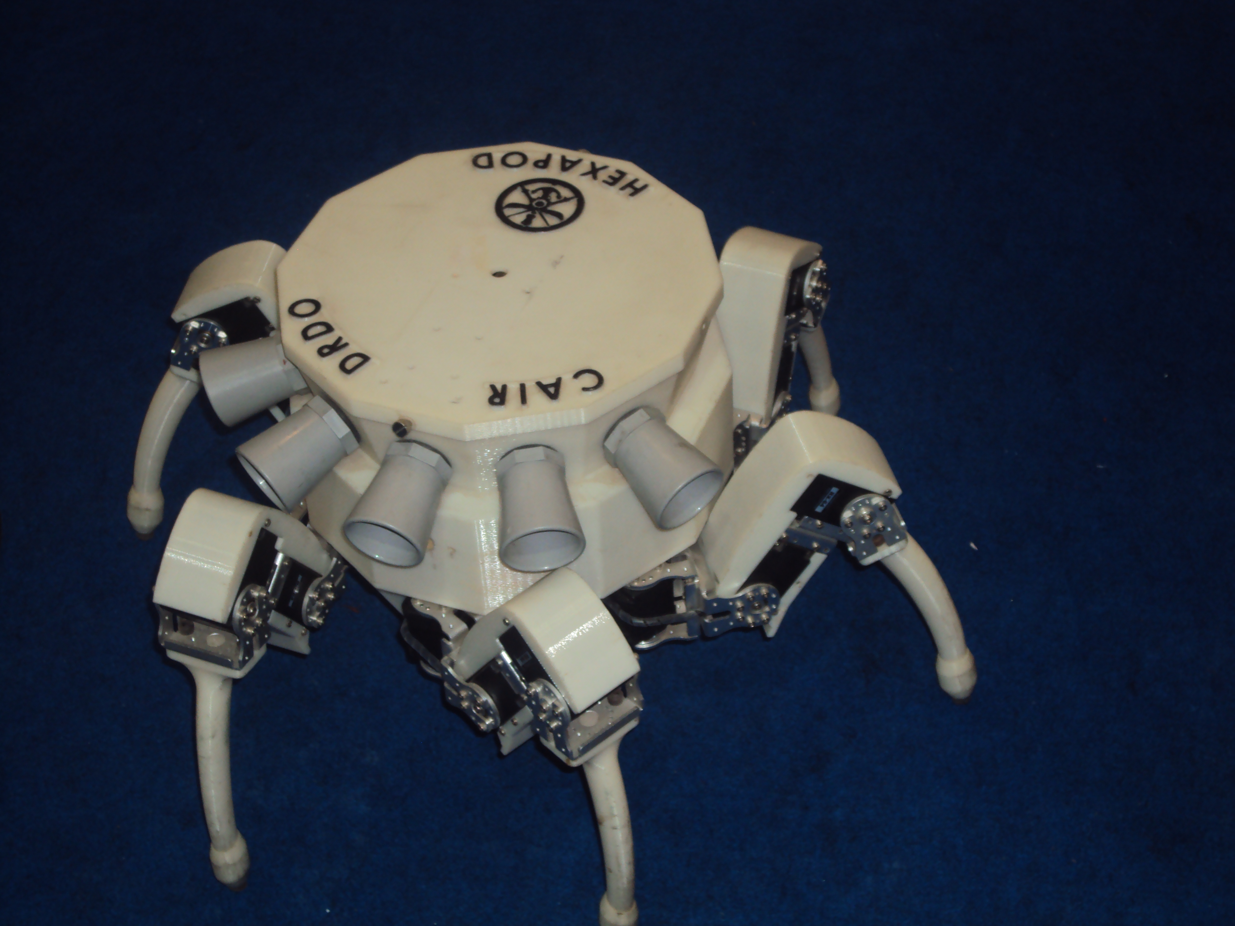 Hexapod is a robot with six legs, each with three degrees of freedom. This enables omni-directional motion. It can walk on rough terrain and has ultrasonic sensors for obstacle avoidance.