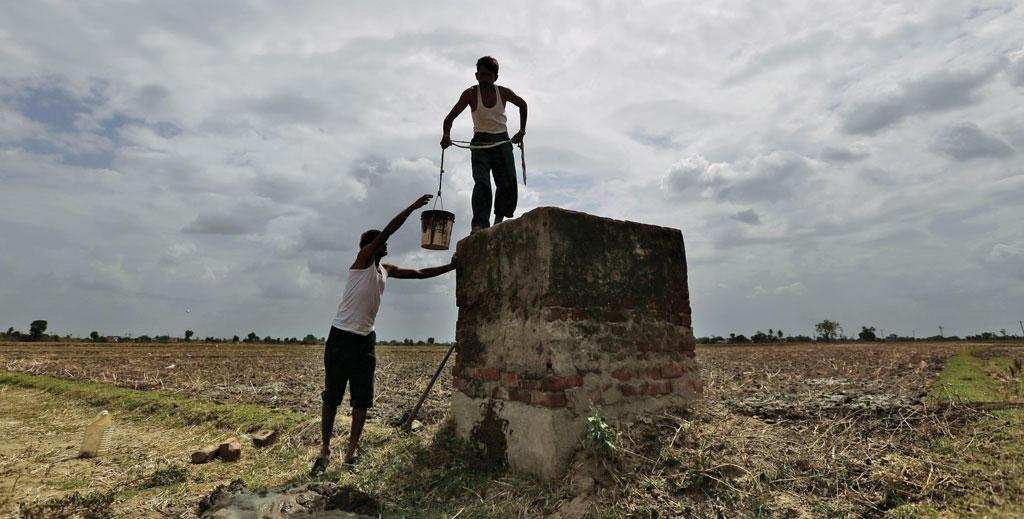 Farmers clean a canal