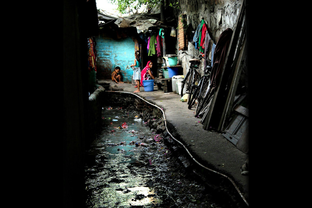 The Jagdamba Camp nullah, or drain, runs past a mosque that was deliberately extended to block the smell, because it was disturbing worshippers. Such open drains are the norm in Delhi slums. They carry untreated sewage and waste directly into the Yamuna river: the 22-km stretch from Wazirabad to Okhla accounts for over 70 per cent of the river's total pollution