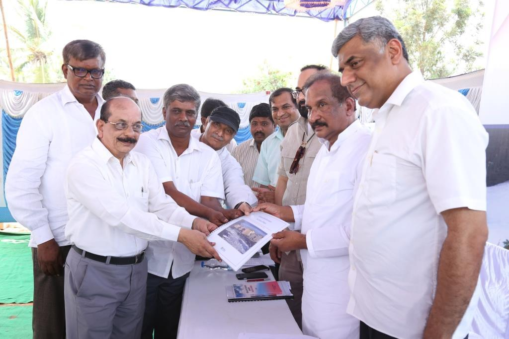 Sridhar Pabbisetty of Namma Bengaluru Foundation hands over 'Save Bellandur Action plan' to  Bengaluru Development and Town Planning Minister K J George (Photo courtesy: Namma Bengaluru Foundation)