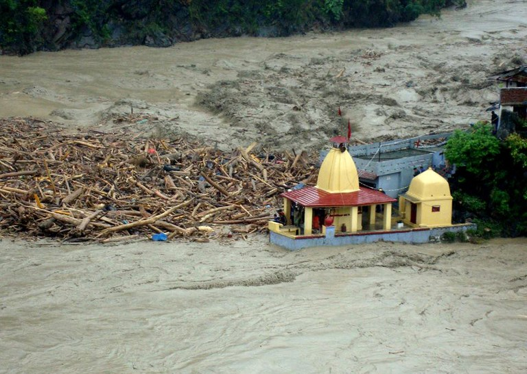 Debris carried by floodwaters of the River Alaknanda crashes against a Hindu temple in Chamoli district of Uttarakhand on June 18, 2013   Credit: Flickr