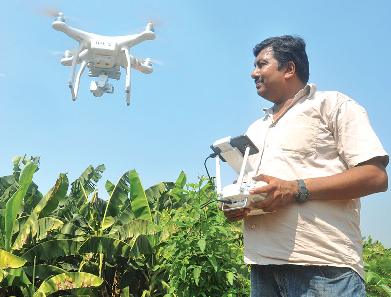Chhattisgarh farmer Rahul Chawda uses drones for farming because of acute labour shortage (Photo: Purusttam Singh Thakur)