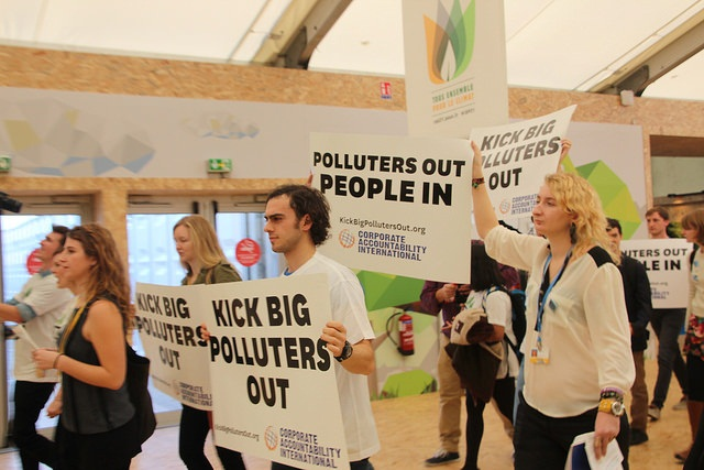 Activists at COP 21 in paris. In his speech, US secretary of state John Kerry deliberately kept missing only one target: namely the role of his own country in creating the problem and then denying that role