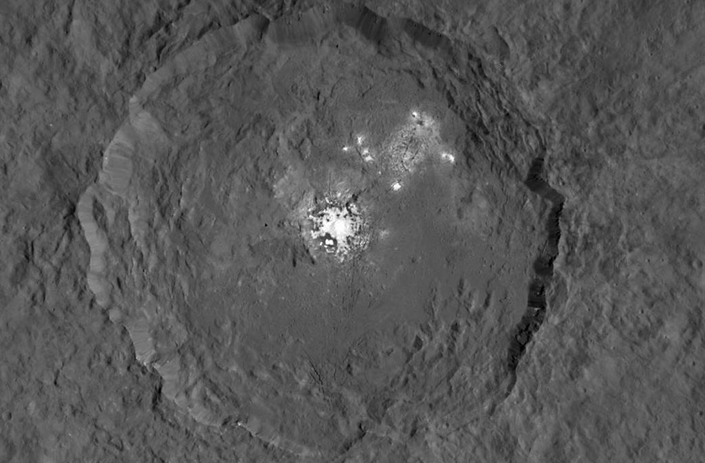 The image, made using images taken by NASA's Dawn spacecraft, shows Occator crater on Ceres, home to a collection of intriguing bright spot Credits: Image credit: NASA/JPL